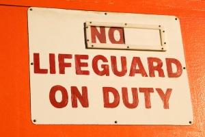 No Lifeguard On Duty sign on a lifeguard station on Waikiki Beach on Oahu, Hawaii
