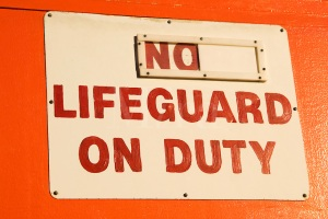 No Lifeguard On Duty sign on a lifeguard station on Waikiki Beach on Oahu, Hawaii